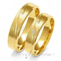 Obrączki żółtego złota z kamieniem - złoty skorpion