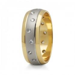 Obraczki ślubne z białego i żółtego złota z kamieniami